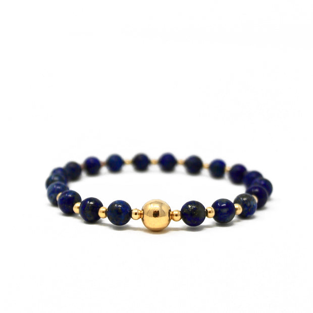 The Tommy bracelet. 14k gold filled. Stretch elastic cord. Non tarnish. Water safe. Lapis lazuli.