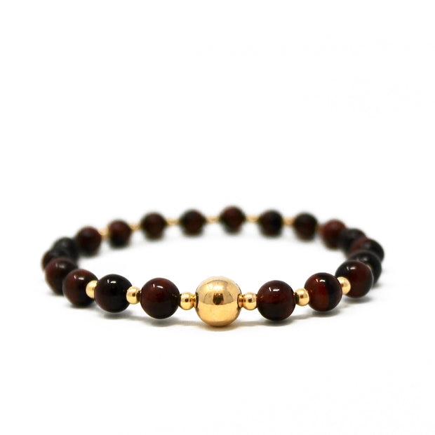 The Tommy bracelet. 14k gold filled. Stretch elastic cord. Non tarnish. Water safe. Red tigers eye.