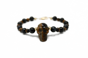 The tonka bracelet. 14k gold filled. Blue tigers eye. Tigers eye. Skull pendant. Flex wire. Stretchy elastic cord. Macramae. Non tarnish. Water safe.