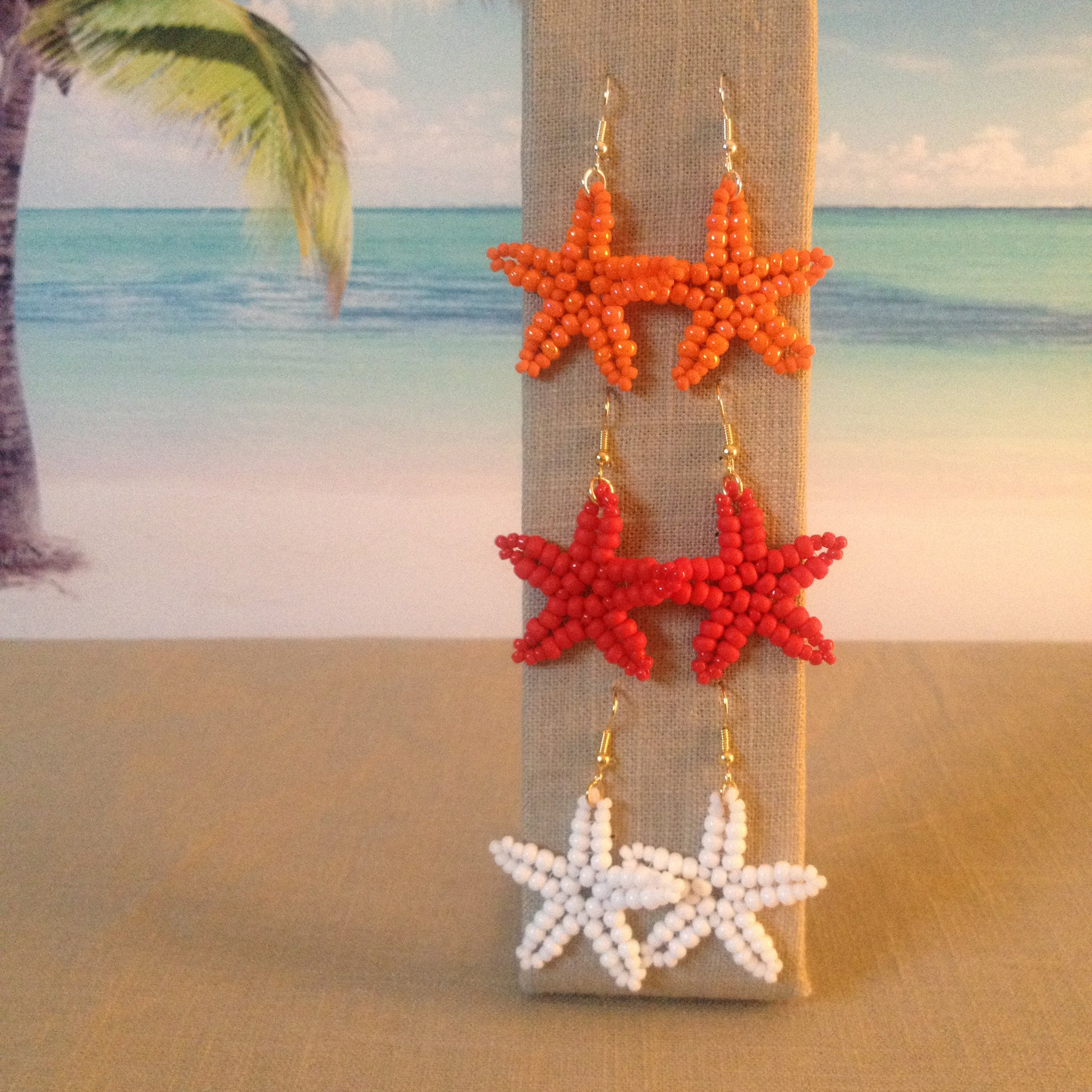 Starfish Beaded Earrings Handmade Vibrant Beach Colors coral orange red white  summer beaded by the beach fun ocean resort hypoallergenic cruise pool prime amazon