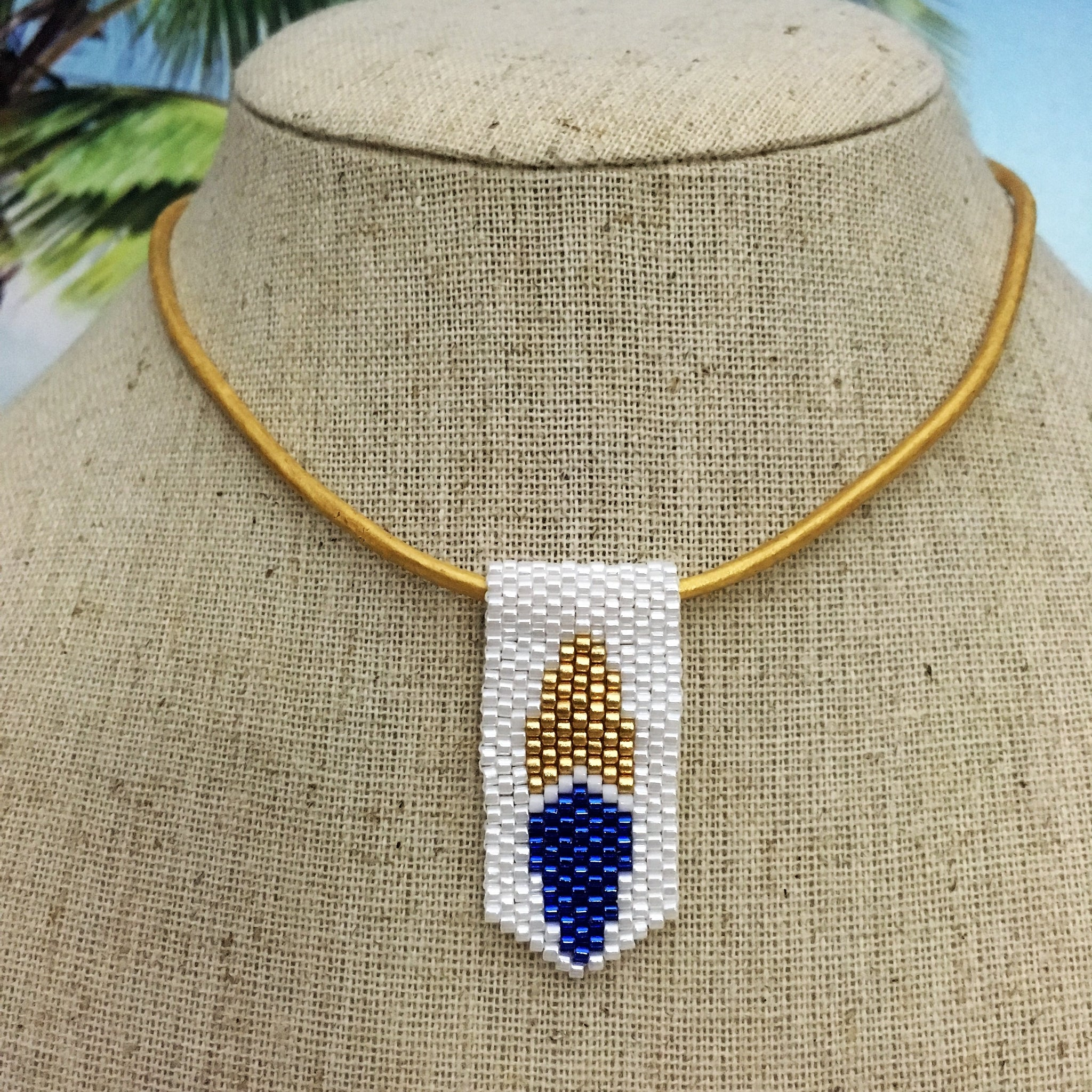 Handmade beaded mini surfboard pendant on leather cord blue white yellow gold