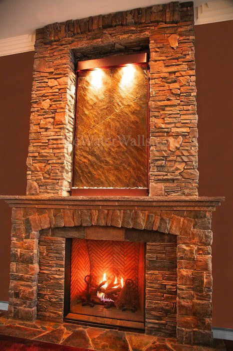 wall water fountain above fireplace