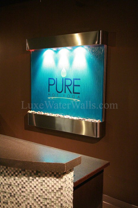 blue glass wall fountain with logo