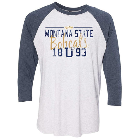 A white shirt with mid length blue sleeves taht says Montana State Bobcats 1893