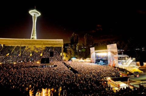 A crowd during Bumbershoot at a stage close to the Space Needle.