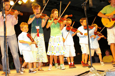 A family performing during the Oldtime Fiddle Festival and Contest.