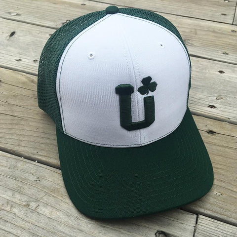 A green and white mesh hat with the UPTOP logo and a shamrock.