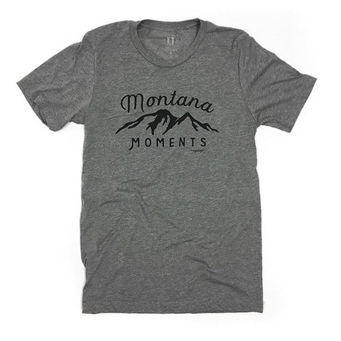Grey tee shirt with the outline of a mountain in black that says Montana Moments