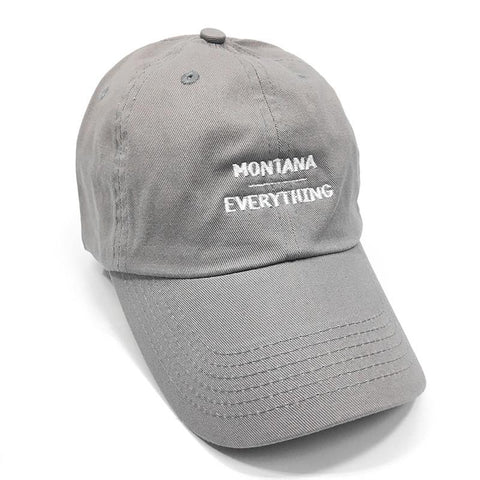 A grey hat that says Montana, with a line under it and Everything below it in white lettering.