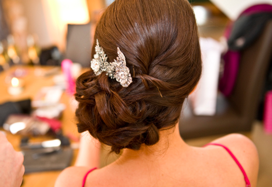 Wedding hairstyles to wear with a one shoulder dress