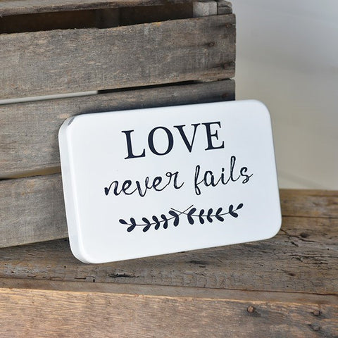 "Love Never Fails - 11"" Tin Sign"