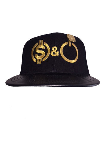 Black & metallic gold MONEY & POWER snap back with leather bib and gold pin.