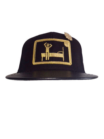Black & metallic gold GET MONEY snap back with black leather bib and gold pin.