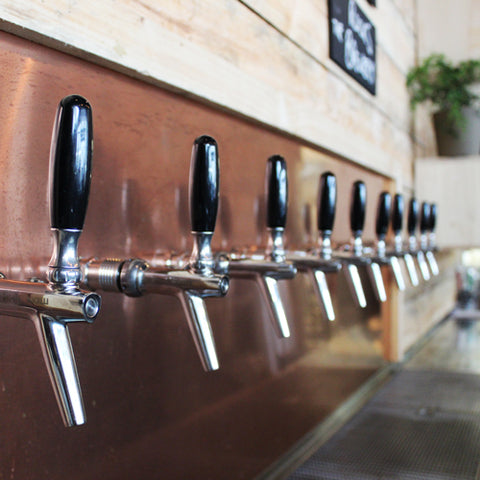The rocks taps and copper splashback