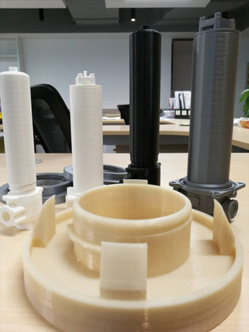 Various 3D printed models featuring a non-standard end cup model with a gap for a rubber ring.