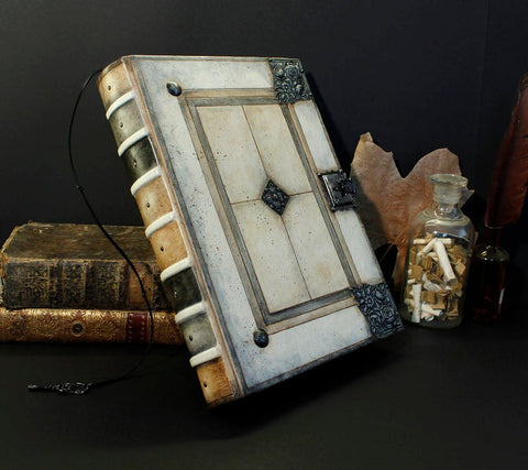 Large white journal with metal hardware