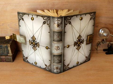 White leather and brass journal