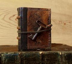 vintage leather miniature journal with antique key