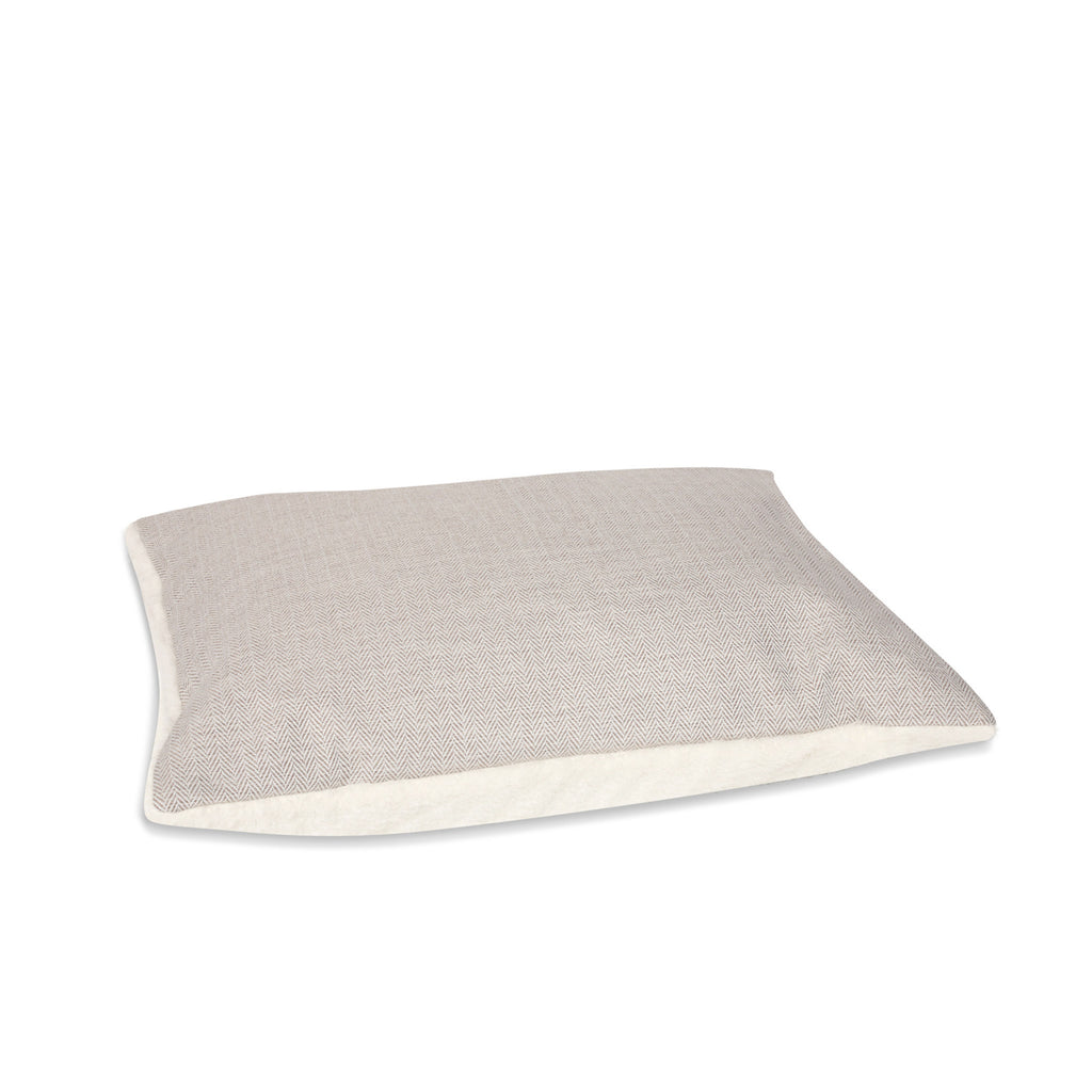 KONA CAVE® designer Snuggle Cave dog bed in cream herringbone fabric with removable pillow.
