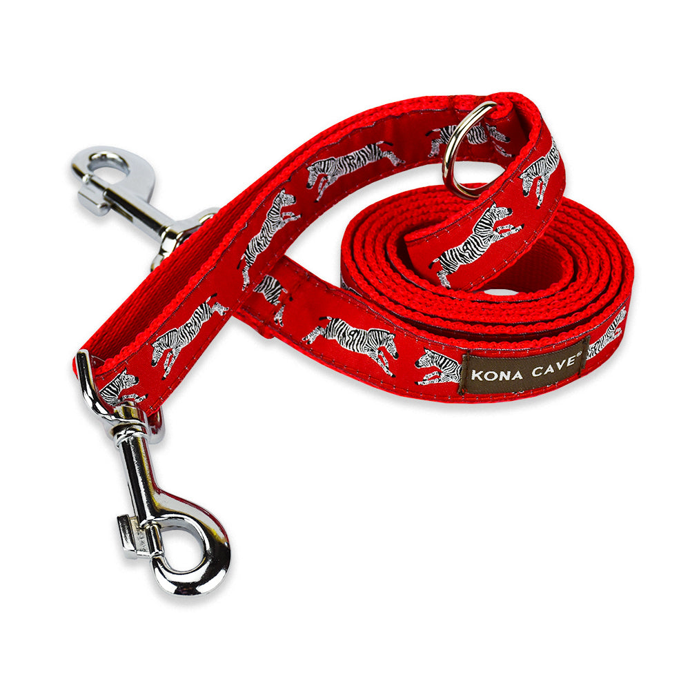 Zebras on a field of red make up the eye-catching pattern on the KONA CAVE® Dog Leash