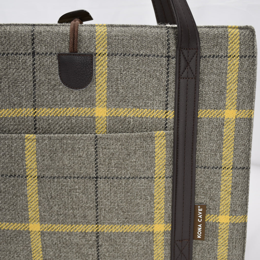 Close up of front pocket, reinforced shoulder straps and one handed toggle closure details on the front of the KONA CAVE® Travel Dog Bed in Grey Beige Country Plaid with Yellow