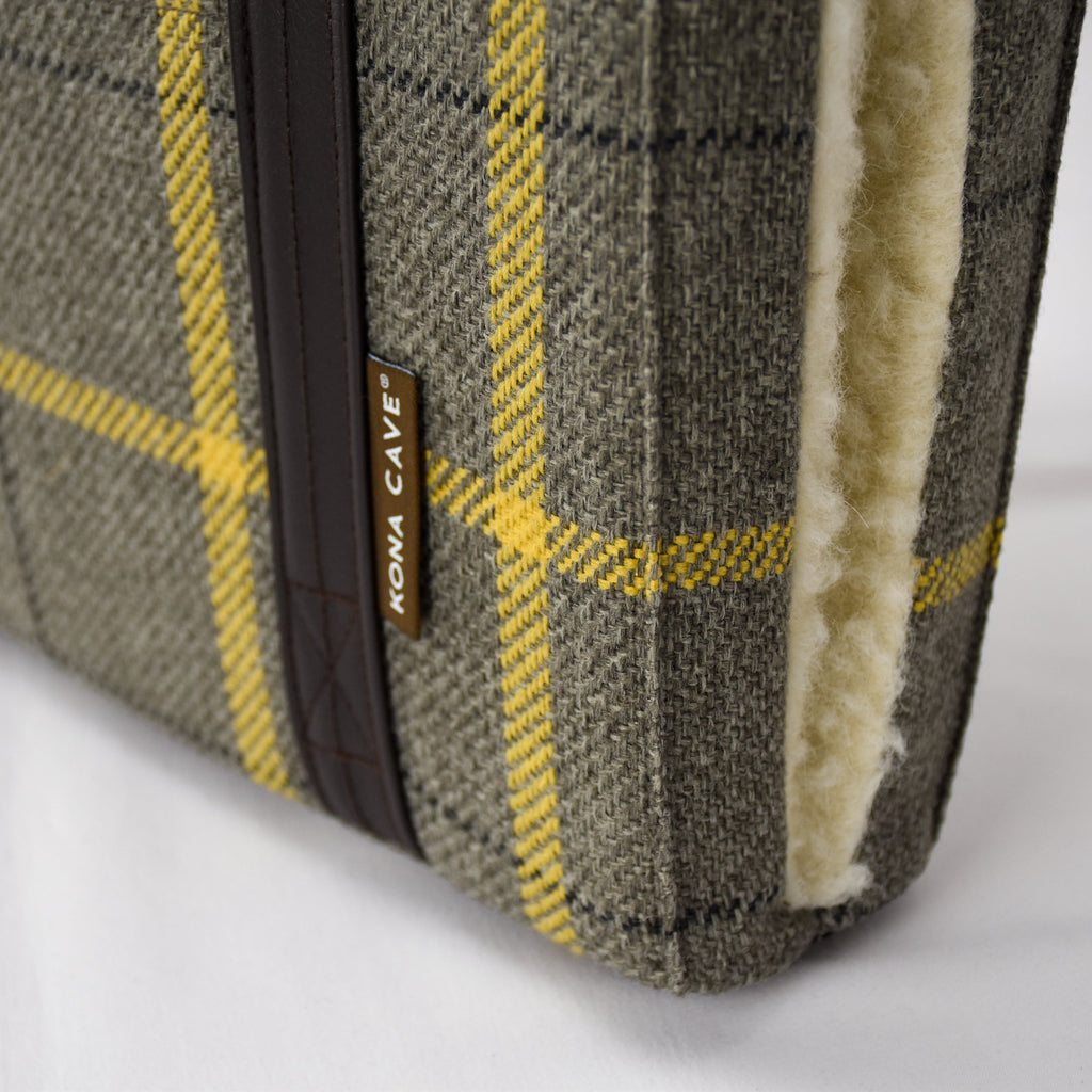 Close up of the beige and gold semi-stain resistant designer fabric and real shearling wool lining on the KONA CAVE® Travel Dog Bed