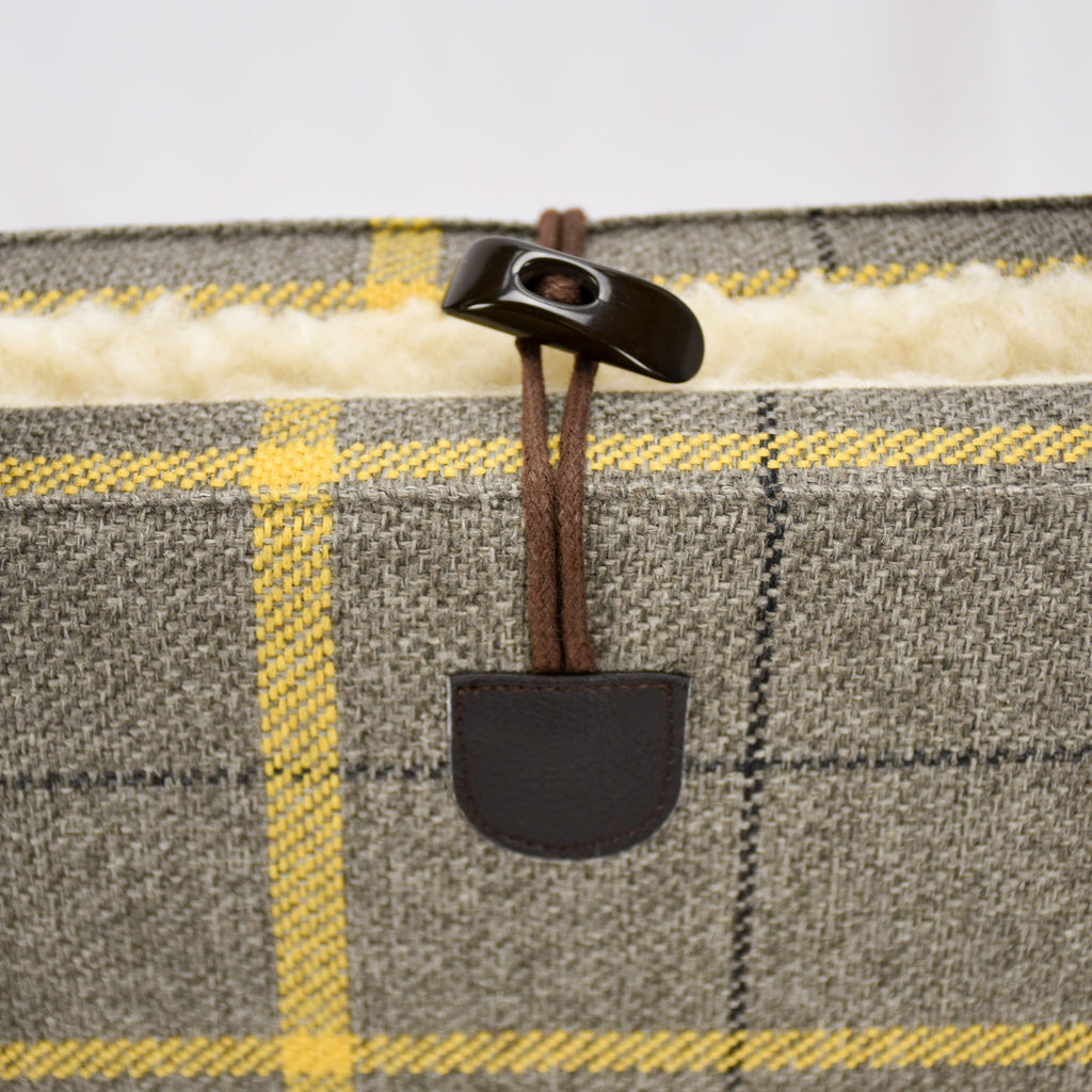 Detail of the brown single handed toggle fastening on the top of the KONA CAVE® Travel Dog Bed with sheep-friendly real wool lining