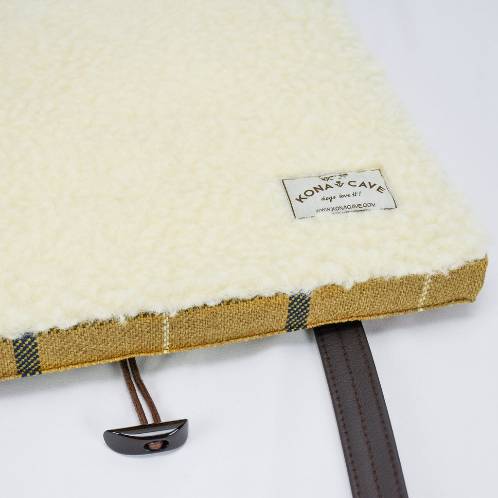 100% real shearling wool lining in the inside of the KONA CAVE® Travel Dog Bed in Gold Country Plaid helps regulate temperature