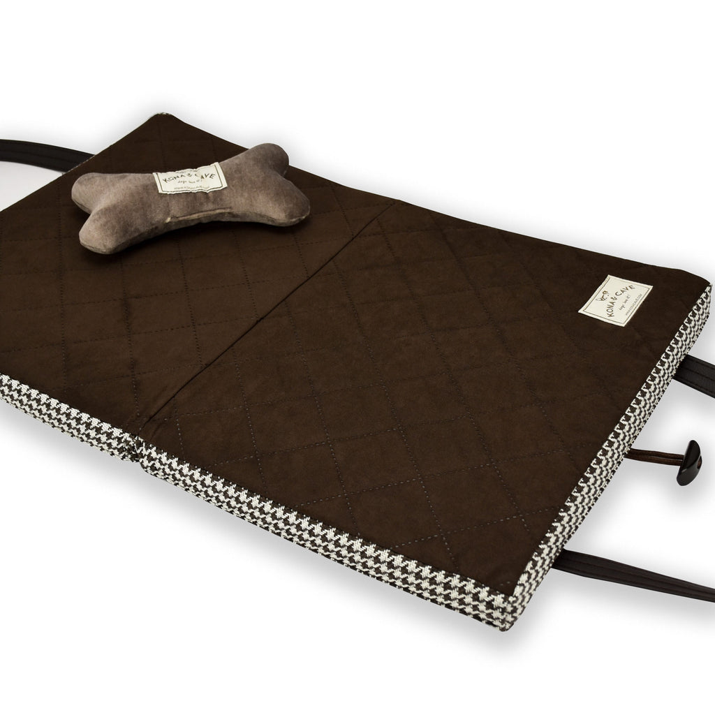 Brown quilted ultra-suede lining of the KONA CAVE® Travel Dog Bed with a velvet toy dog bone