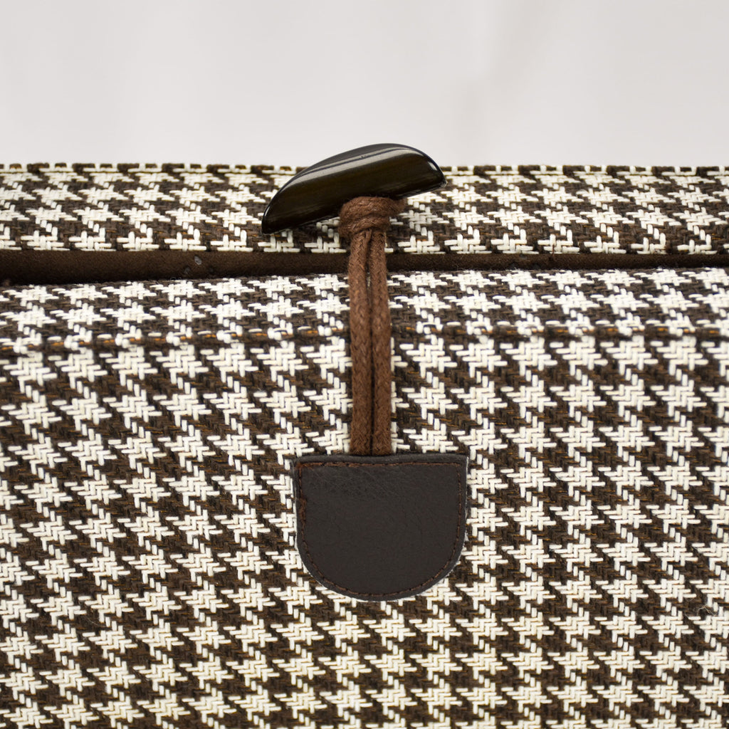 Close up of the convenient one-handed toggle closure in brown on the KONA CAVE® Travel  Dog Bed in Brown and White Houndstooth with Brown Quilted Alcantara Lining