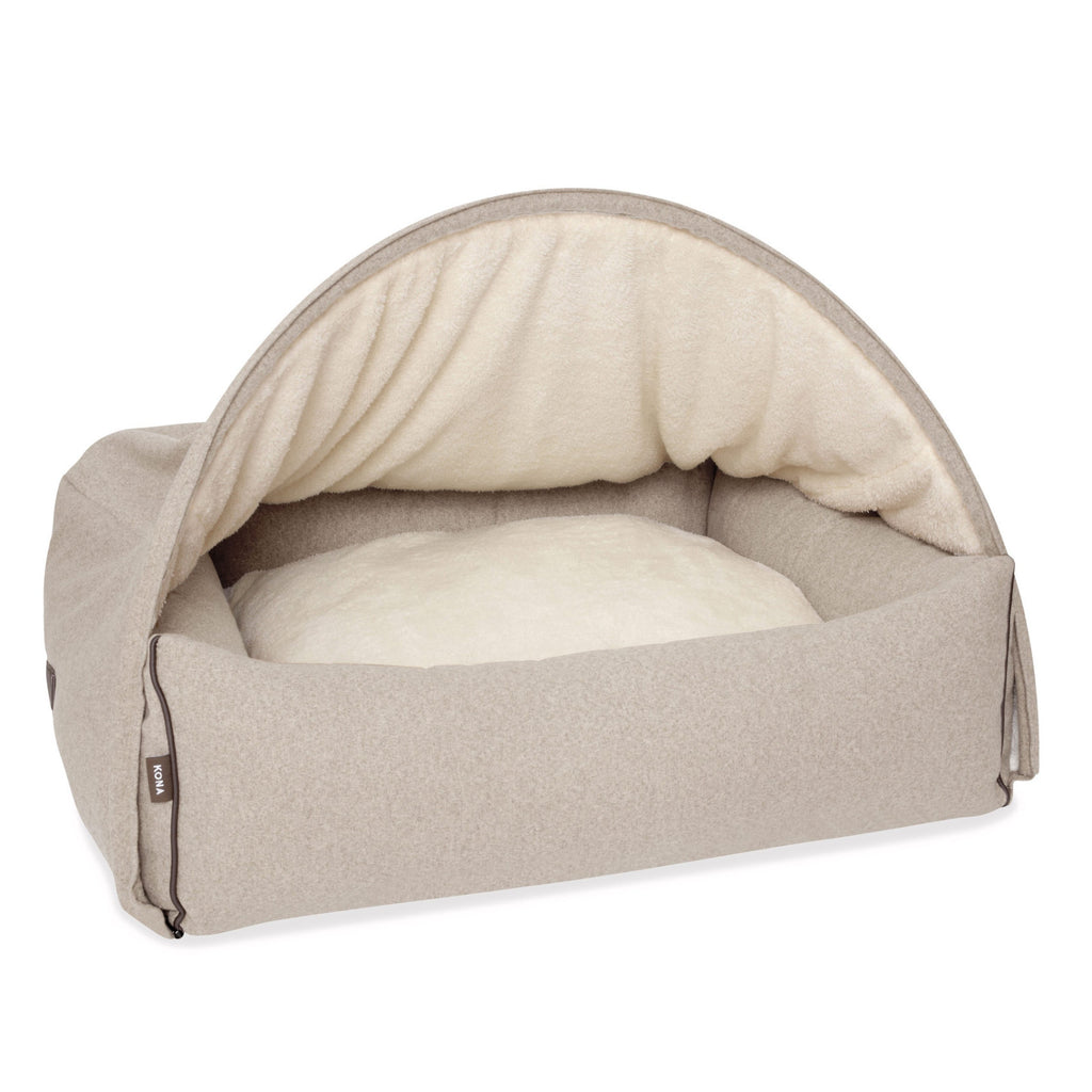 KONA CAVE® designer Snuggle Cave dog bed in beige flannel fabric and leather trim.