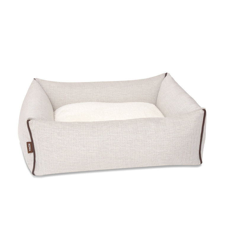KONA CAVE® luxury bolster dog bed in elegant cream herringbone fabric with leather trim