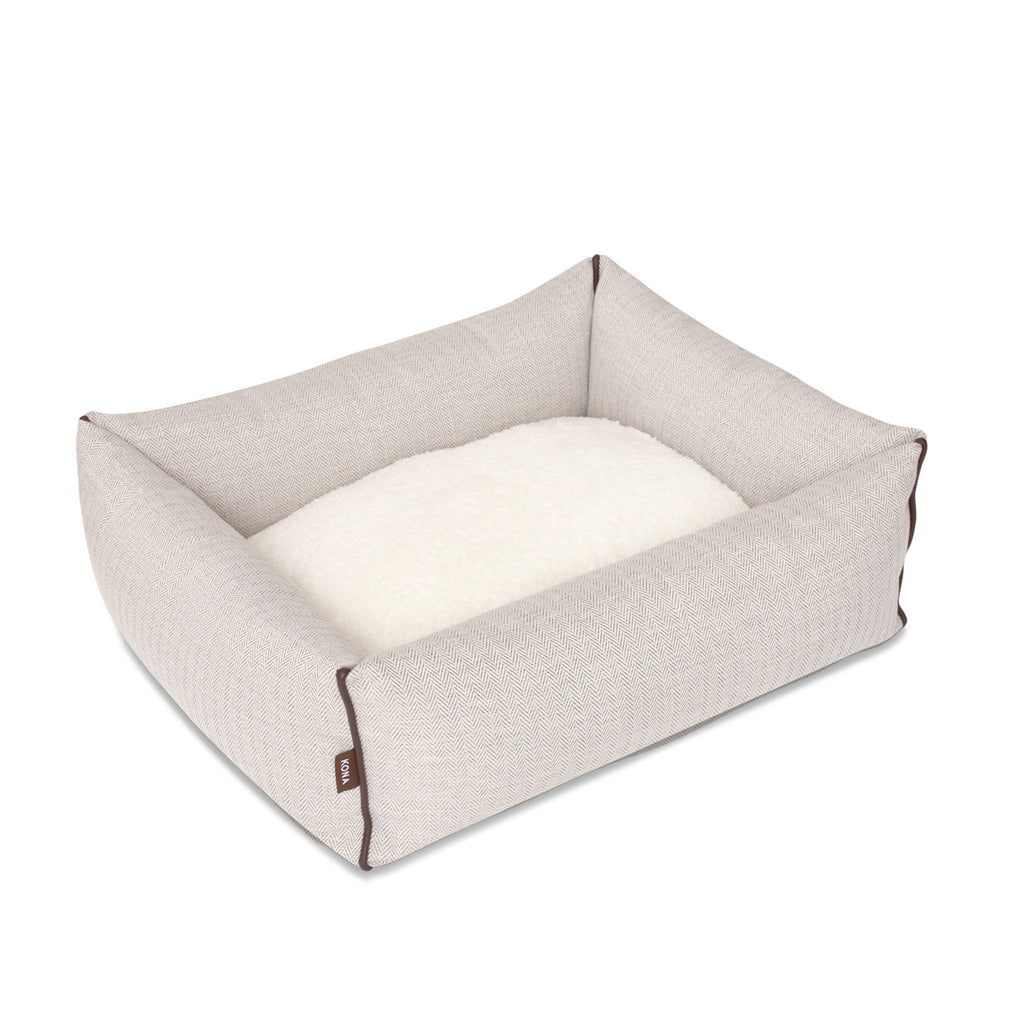 KONA CAVE® luxury bolster dog bed in elegant cream herringbone fabric. Schönes Hundebett.