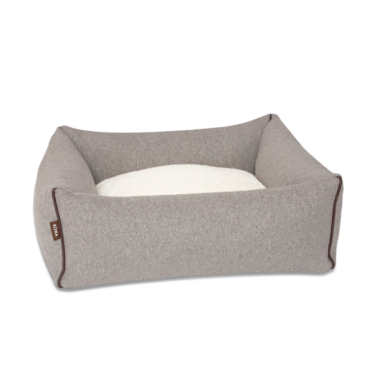 KONA CAVE® luxury bolster dog bed in soft grey flannel fabric with leather trim.