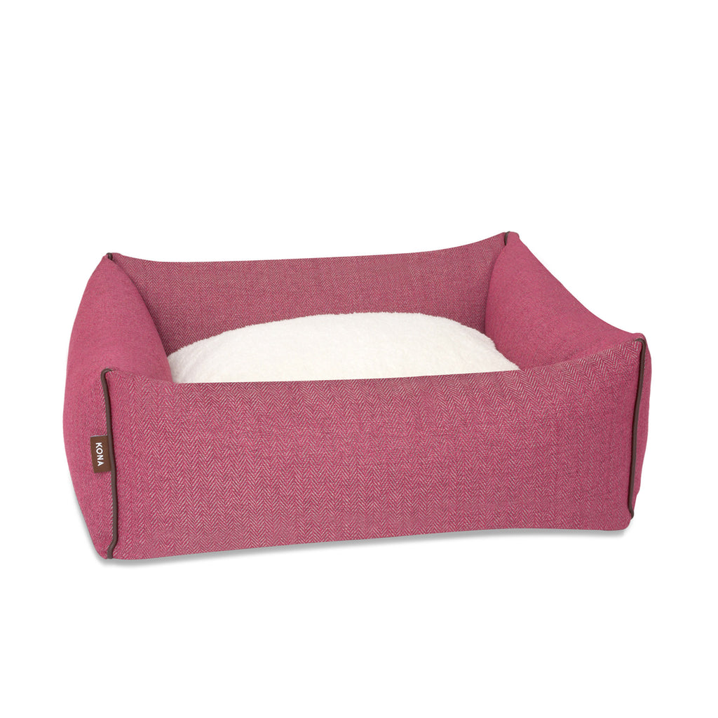KONA CAVE® designer bolster dog bed in elegant pink herringbone fabric with leather trim.  Rosa Hundebett