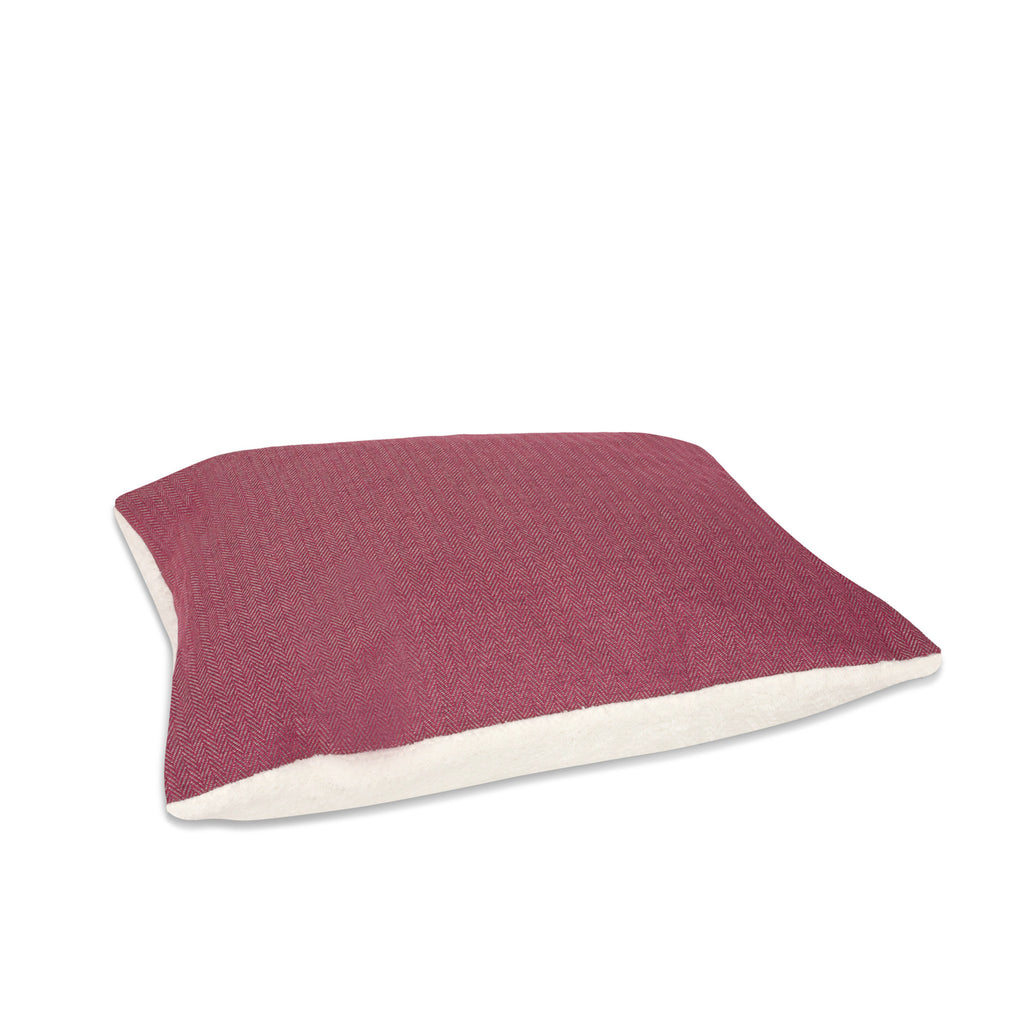 KONA CAVE® designer bolster dog bed in elegant pink herringbone fabric with leather trim.