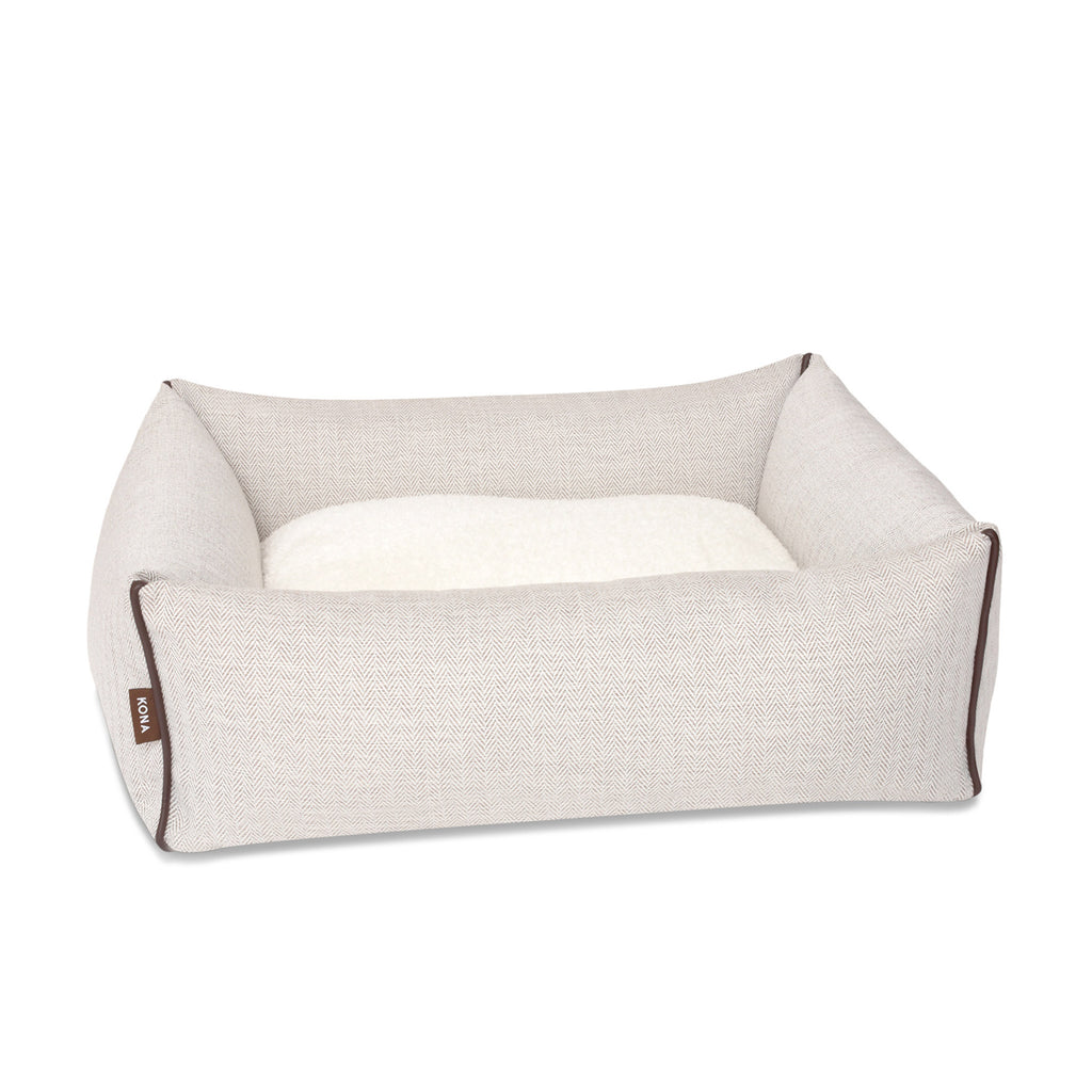 KONA CAVE® designer Snuggle Cave dog bed in cream herringbone fabric with removable cave cover.