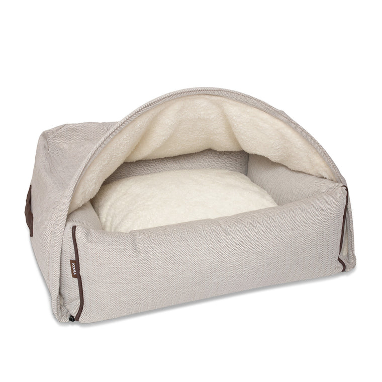 KONA CAVE® designer Snuggle Cave dog bed in cream herringbone fabric with leather trim.  Hund Höhlenbett.