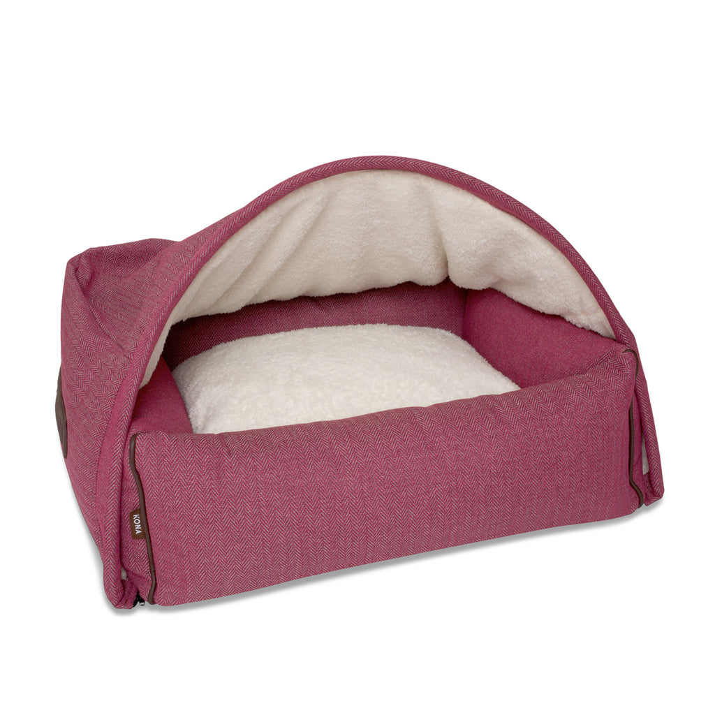 KONA CAVE® patent protected designer Snuggle Cave dog bed in dark pink herringbone fabric with leather trim.