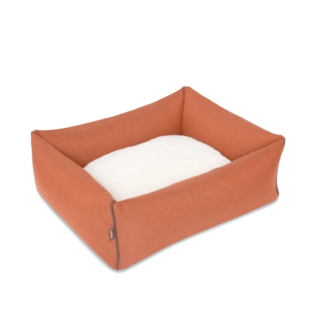 KONA CAVE® designer Snuggle Cave dog bed in sophisticated orange herringbone fabric with removable cave cover.