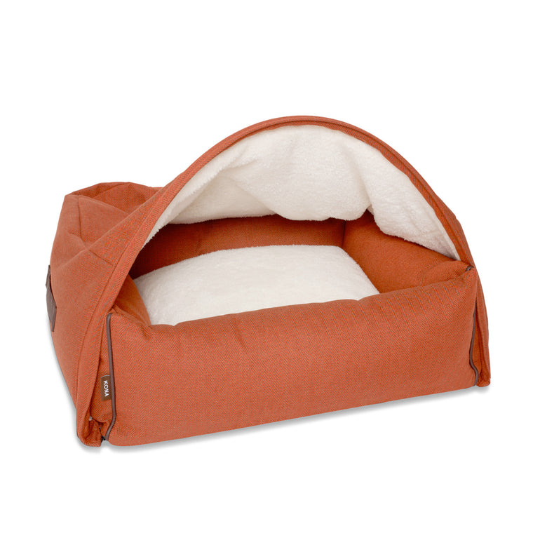 KONA CAVE® designer Snuggle Cave dog bed in sophisticated orange herringbone fabric with leather trim.