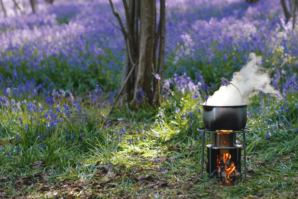Boiling potatoes among the bluebells