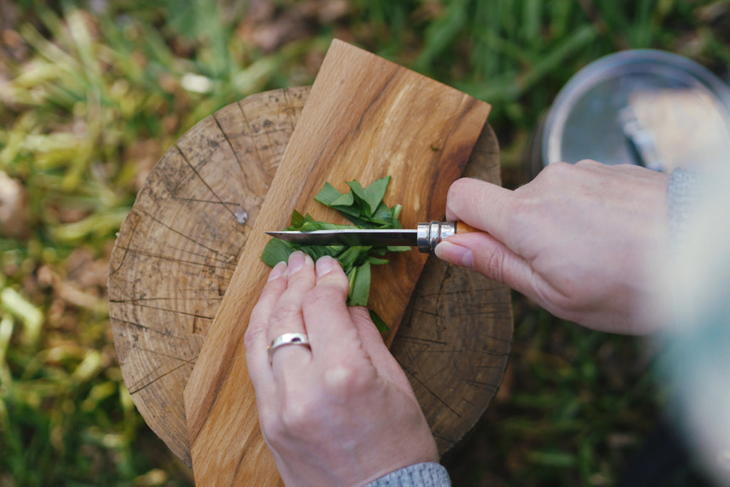 Chopping wild garlic outdoors