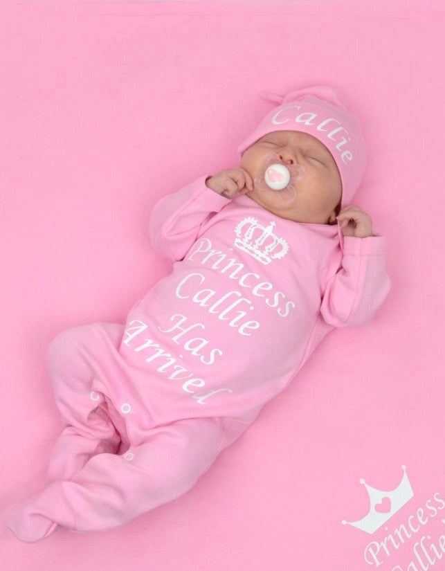 Personalised princess has arrived baby grow and hat set