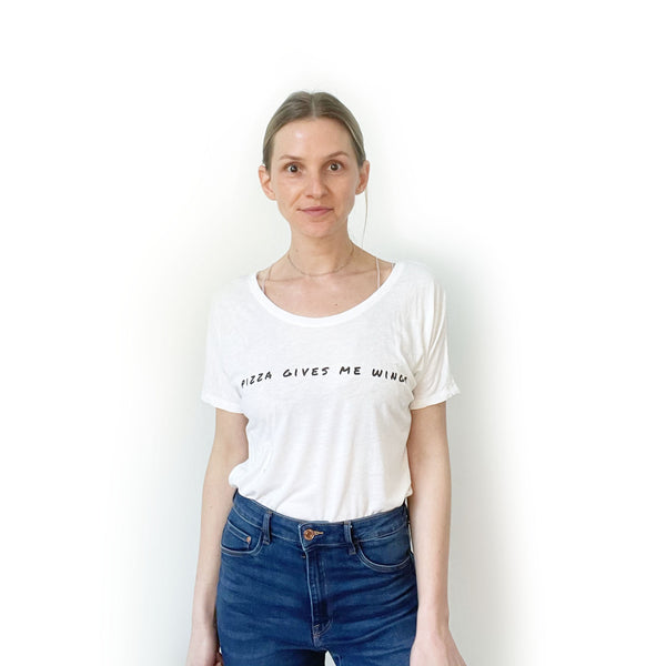 white slouchy t-shirt tucked into jeans