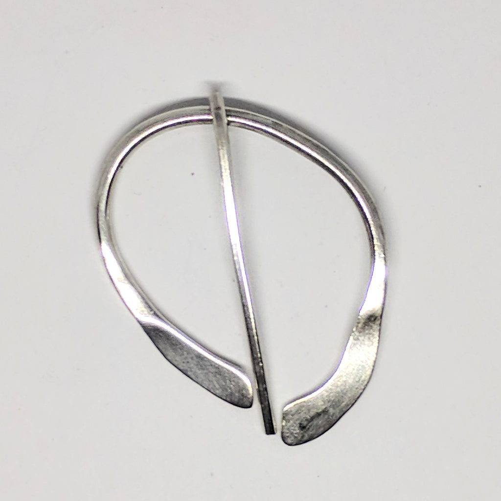 Large asymmetric silver penannular pin