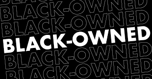 """A black background with the words """"Black-Owned"""" written in white"""