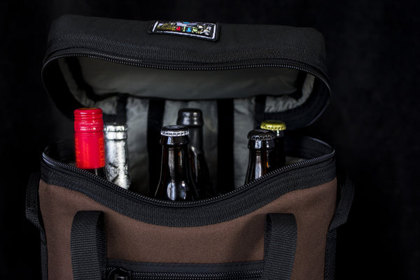 Perfect for a stop at the winery or the new release of a barrel aged stout, the insulated quad wine bottle/bomber cooler keeps 6 bottles safe and cold on the go!
