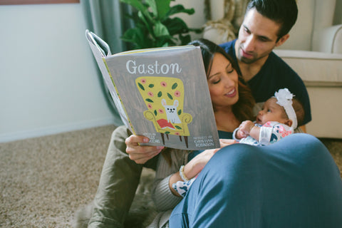 The Ollie World - Parents Reading to a Baby