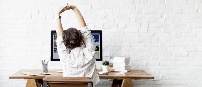5 Yoga Poses You Can Do at Your Desk